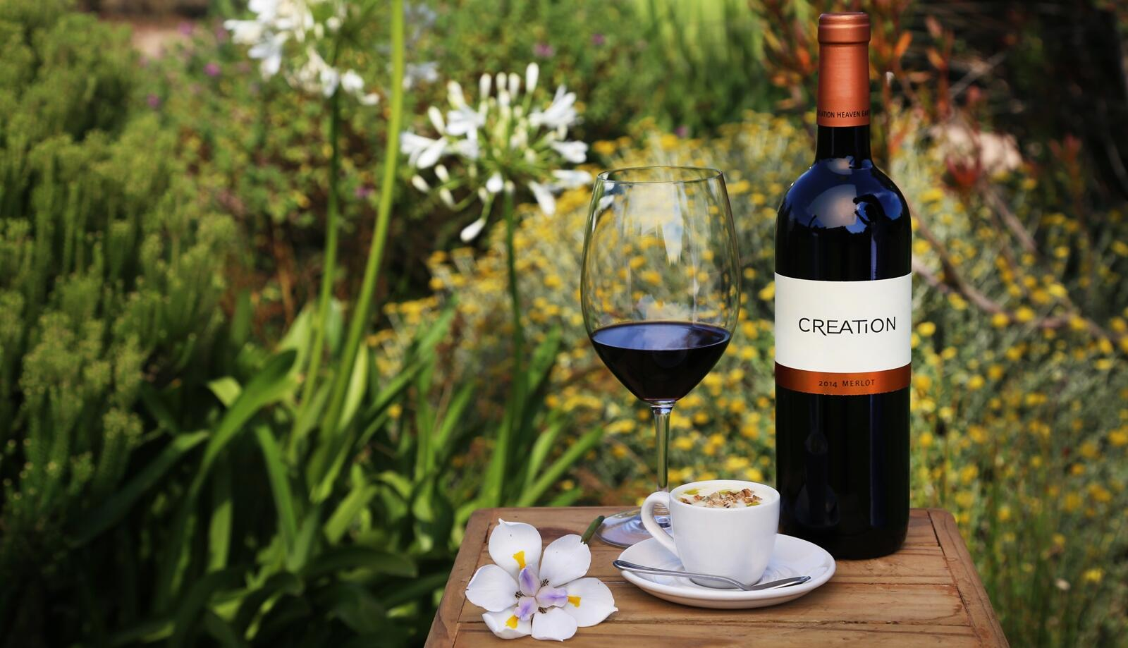 Bottle of Merlot with wild flowers in background